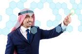 Arab man pressing virtual buttons — Stock Photo