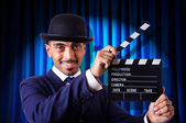 Man with movie clapper — Stock Photo