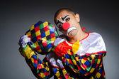 Sad clown against dark background — Stock Photo