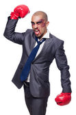 Badly beaten businessman with boxing gloves — Fotografia Stock