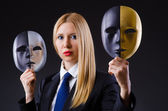 Woman with two masks in hypocrisy concept — Stock Photo