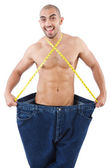 Man in dieting concept with oversized jeans — Stock Photo