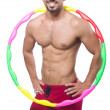 Man doing excecises with hula hoop — Stock Photo