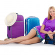 Woman preparing for travel on summer vacation — Stock Photo