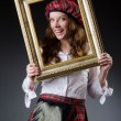 Stock Photo: Scottish womwith frame