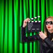 Girl with movie board against curtains — Stock Photo #31867523