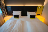 Hotel room with double bed — Stock Photo