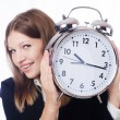 Businesswoman with clock — Stockfoto