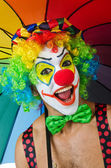 Clown with umbrella — Stock Photo