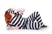 Prisoner in striped uniform — Stock Photo