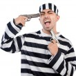 Prisoner with guns — Stock Photo