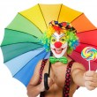 Stock Photo: Clown with umbrelland lollypop
