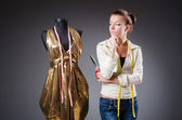 Woman tailor working on clothing — Стоковое фото