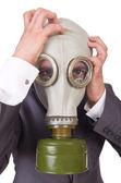 Businessman wearing gas mask — Stock Photo