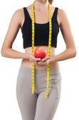 Vrouw met apple doen oefeningen op wit — Stockfoto