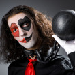 Stock Photo: Clown with shackles