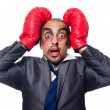 Badly beaten businessmwith boxing gloves — Stock Photo #32814147