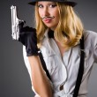 Stock Photo: Funny womwith gun and mustache