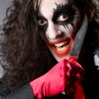 Funny joker with sharp knife — Stockfoto