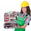 Young womwith toolkit on white — Stock Photo #33158989