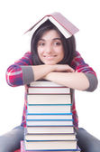 Young female student with books on white — Foto de Stock