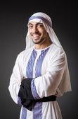 Arab in the dark room — Stock Photo