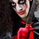 Funny joker with sharp knife — Stock Photo