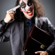 Joker with gun and briefcase — ストック写真