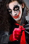 Funny joker with sharp knife — Stock Photo