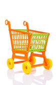 Plastic shopping cart against the white background — Stock Photo