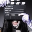 Scary monster with movie board — Stock Photo