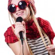 Young female singer with mic on white — Stock Photo
