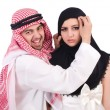 Arab man with his wife on white — Stock Photo