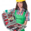 Stock Photo: Young womwith toolkit on white