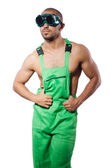 Man in green coveralls with goggles — Stock Photo