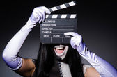 Scary monster with movie board — Stok fotoğraf
