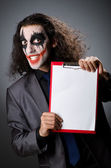 Funny Joker with paper binder — Stock Photo