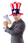 Man with loudspeaker and american hat — Stock Photo
