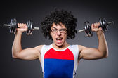 Funny man exercising with dumbbells — Foto Stock