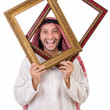 Arab with picture frame on white — Zdjęcie stockowe