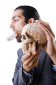 Antismoking concept with man and skull — Stock Photo