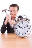 Donna che cerca di rompere l'orologio — Foto Stock