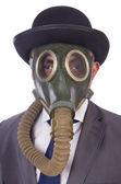 Businessman wearing gas mask isolated on white — Stock Photo