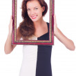 Woman with picture frame on white — Photo
