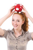 Redhead with piggybank isolated on the white — Stock Photo