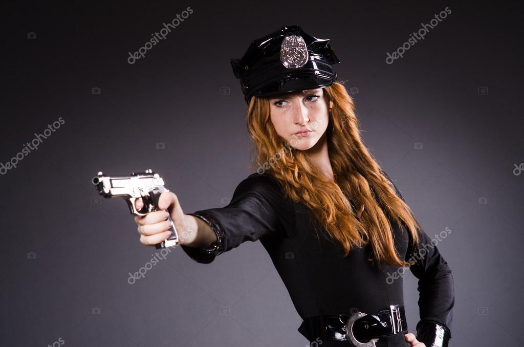 bureau de police de femme avec pistolet photographie elnur 35637527. Black Bedroom Furniture Sets. Home Design Ideas