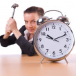Woman trying to break the clock — Stock Photo #35644525