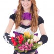 Stock Photo: Magiciwomwith flowers on white