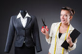 Woman tailor working on clothing — Stock Photo