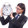 Young businessman with clock on white — Stock Photo